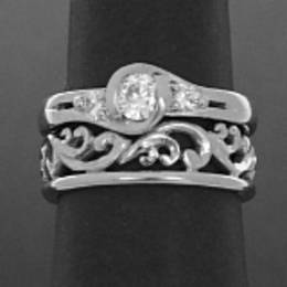 R279F Fitted carved Fine koru wedding band in White Gold