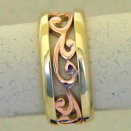 R251 Roseand yellow gold carved koru band