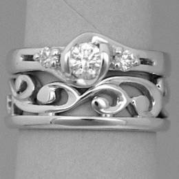 Fitted white gold carved koru wedding band  Style R251F