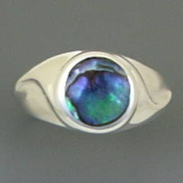 R234  Paua Shell in a Stg.Silver band.