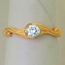 R308 Diamond and koru engagement ring set in yellow Gold.