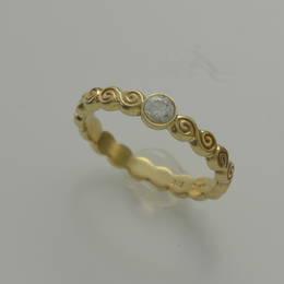 Diamond set Celtic Spiral /Koru band in yellow gold .