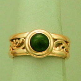 Pounamu NZ Greenstone on a fine koru band set in yellow Gold