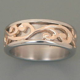 R251a Silver and rose gold Carved Koru Band
