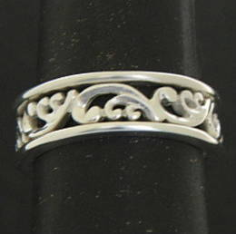 R279 Fine carved koru band in Silver.