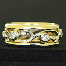 R251 6x Diamonds set  around a carved koru design wedding ring