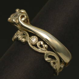 Vintage style, diamond set koru wedding band