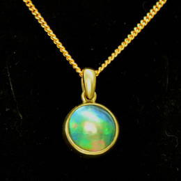 P58 Gold and 10mm. Paua Pearl Pendant
