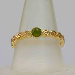 R360 Celtic Spiral band in yellow gold set with Pounamo New Zealand greenstone.
