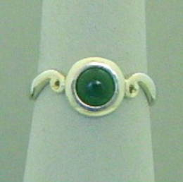 Pounamu NZ Greenstone on a Koru band set in Stg. Silver.