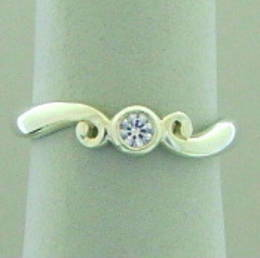 Koru and Diamond ring
