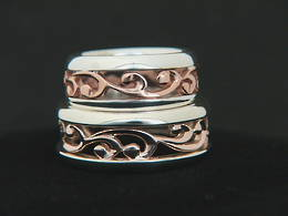 R251 Rose Gold and Silver carved koru band