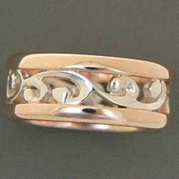 R251b Silver and Rose gold carved koru band