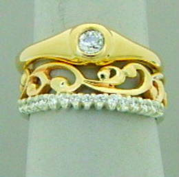Fitted gold carved koru wedding band diamond set